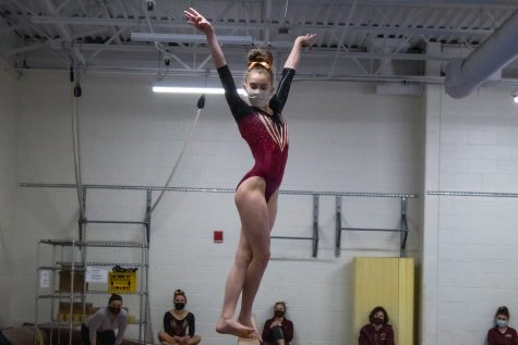 Freshman Olivia LaBelle performs her beam routine at the January 16 meet against Groton-Dunstable.