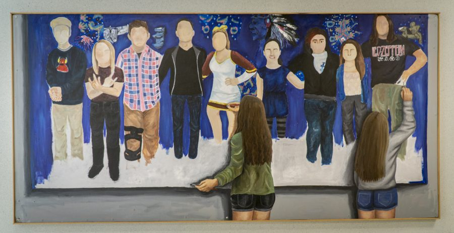 This painting of two girls painting a mural hangs in a hallway near the main entrance of the school. While the mural in the art is meant to represent Algonquins diverse student body, there are no people of color shown, a pattern seen in much of the other art around the school.