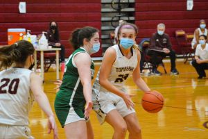 Junior Danielle Adams looks to pass the ball to her teammate, senior Jenny Lambert. Algonquin ultimately lost to Wachusett 59-41 on February 12.