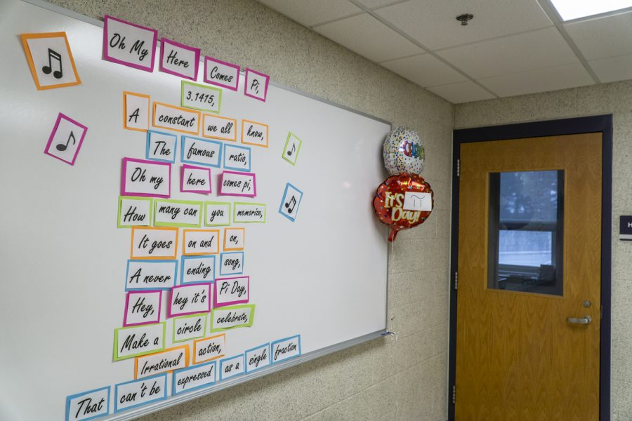 In the H300 hallway, a song about pi is displayed on a whiteboard along with balloons in celebration of Pi Day which was March 14th.