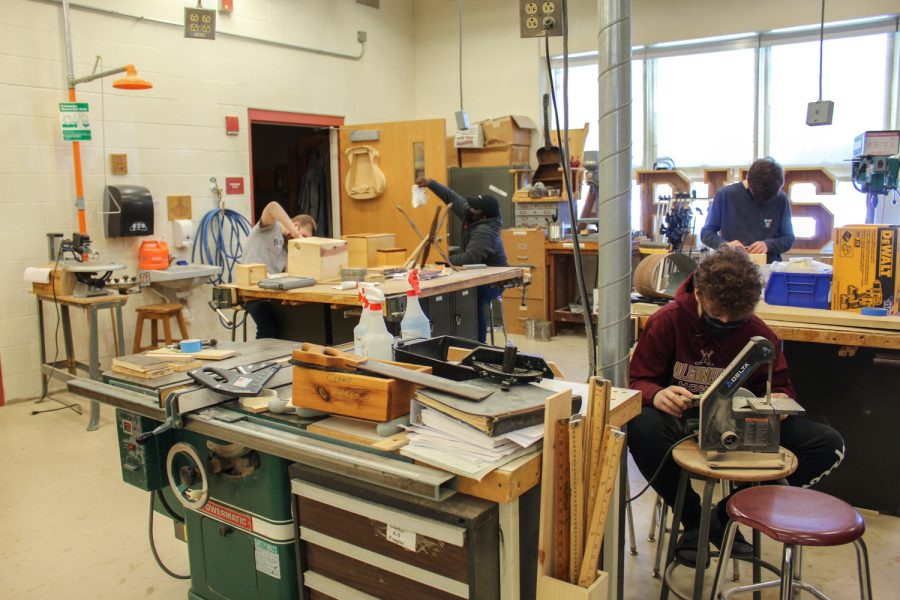 During Applied Arts & Technology teacher John French's Wood Tech class, students work on finishing up projects before the term ends.