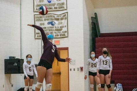 Senior Yasmin Lee serves  as her teammates look on from the sidelines.  The girls' varsity volleyball team defeated Shrewsbury 3-0 on April 1.