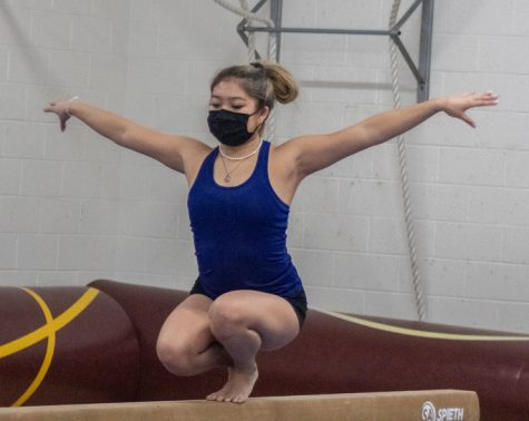 Senior Acacia Truong shows her skill on the beam at a meet this past season. Truongs beam routine is one of her focus events for competing.