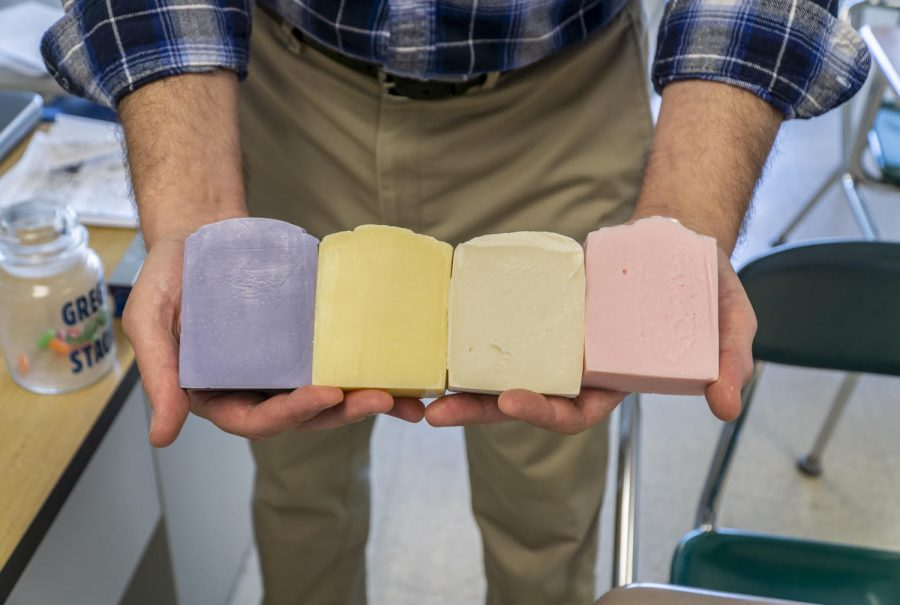 History teacher Gregory DeCosmo holds a new batch of soap after they've finished curing.