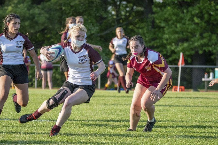Junior Colleen Mulligan running to the opponents side of the field in order to get a try, which is a way to score points in the sport. The girls rugby team ended up winning against Weymouth 14-10.