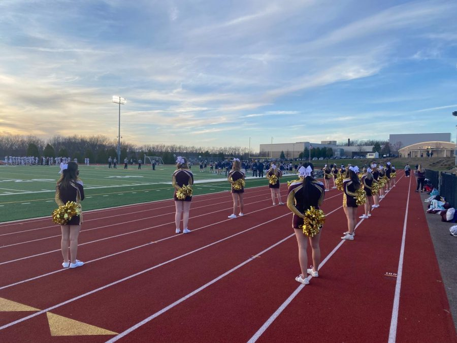 The+Algonquin+cheerleading+team+cheers+at+a+football+game+at+Shrewsbury+during+this+past+season.+The+team+continued+to+stay+motivated+despite+COVID-related+challenges.++