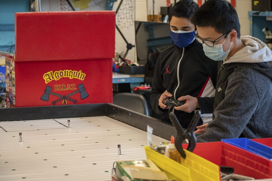 Sophomore Shivnath Shankar and freshman Jon Wang, who are both part of Robotics Club, work together to keep a Raspberry Pi powered robot on its course.