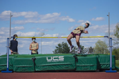 Sophomore Matt Pianka clears the high jump bar. The boys fell short of the win against the Mountaineers.