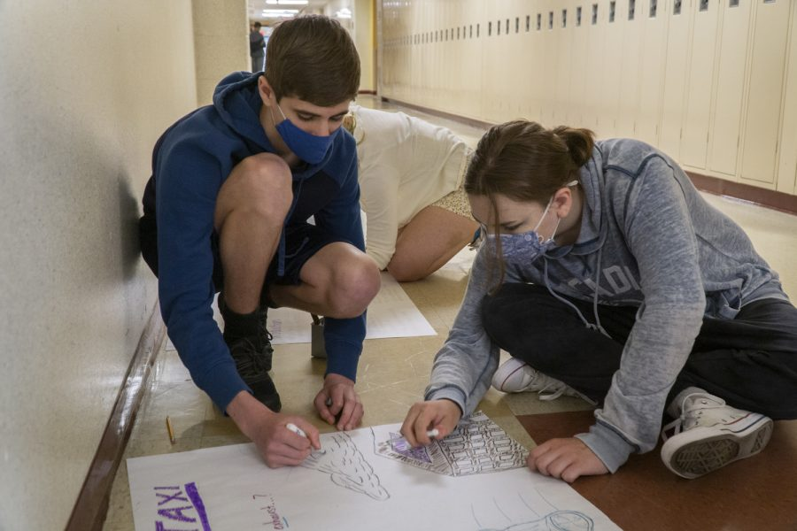 Freshmen Zach Arvantely and Natalie McNeil cooperate on a project assigned to them for their US History I class.