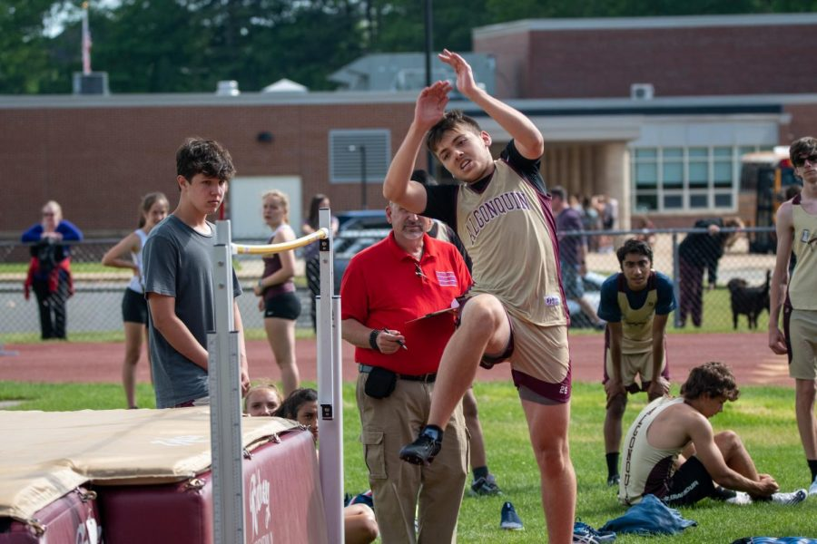 Sophomore Trevor Kerxhalli clears the high jump at the meet against Advanced Math & Science Academy Charter on June 1st. This is one of their first meets without the requirement to wear masks.