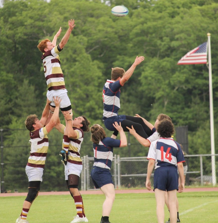 Two Algonquin rugby players lift their teammate, Edward Gostick, in a lineout in order to get the ball during the boys rugby game against Brookline on June 3rd.