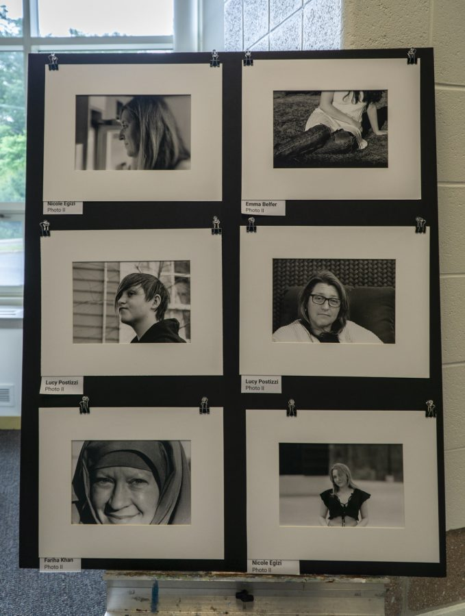 Photos made by Photo II students are put on show in the library.