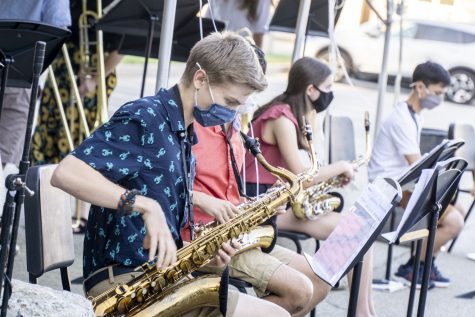 Middle and high school students prepare for their performance in Algonquins parking lot at the ARHS and Melican Jazz Night.
