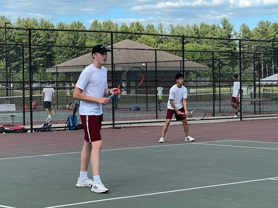 First doubles pair senior Joshua Cheng and sophomore Cameron Jackson warm up for their match against Groton Dunstable.