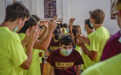 Peer mentors welcome the class of 2025 into the gym for the freshman dance.