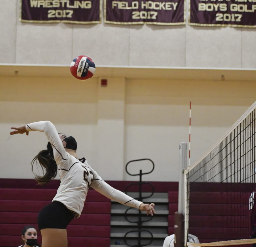 Junior Mia Dobosh Spikes the ball. Algonquin was defeated by Westborough 0-3 on September 17.