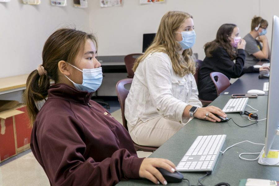 Sophomores Liana Meehan and Renee Gauthier begin their classwork for their Photography I class.