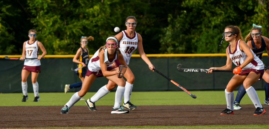 Freshman Gaby Lomuto (left) and freshman Lindsey Brown (right) waits to get the ball and run it back down the field. Algonquin was defeated by Acton-Boxbrough 6-1 on September 24.