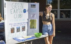 Senior Jada Carter-Frem, a member of the Green Earth Club, stands in front of her stand at the Activities Extravaganza on Wednesday, Sept. 29.