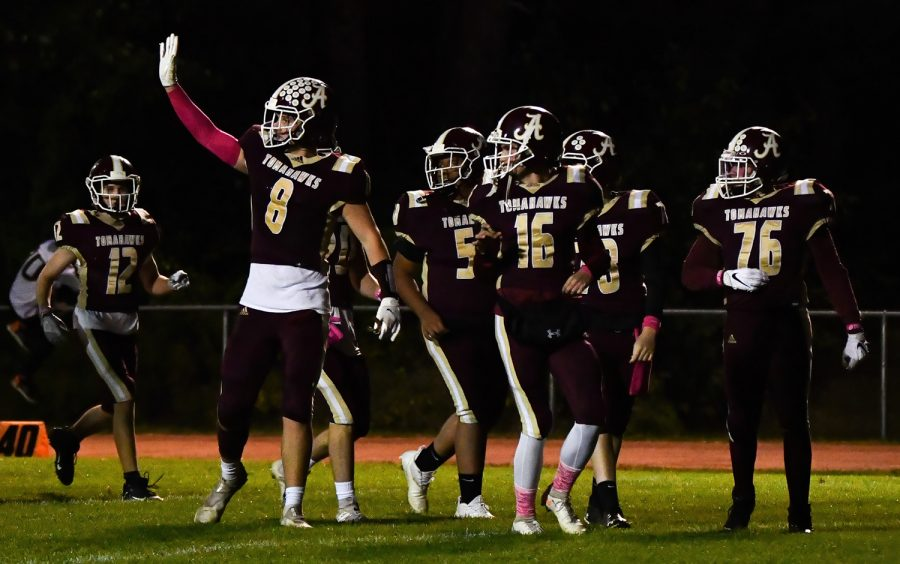 After winning their game against Shrewsbury High School, ARHS football players wave to the crowd.