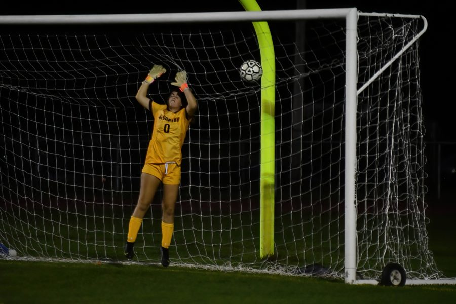 Junior Keely Scott stops the ball from going in the net against Westborough. The game ended in a 0-0 tie.