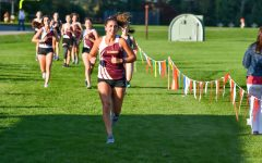 Trying to stay ahead of the pack, senior Joli Dantz keeps her pace. Algonquin won the meet against Shrewsbury 25-32.