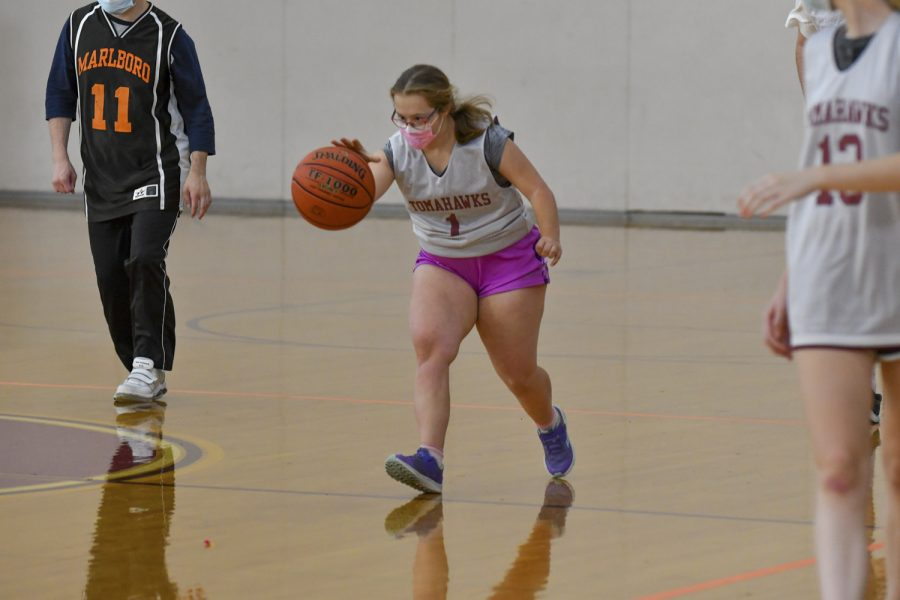 Post-grad Sofia Roumiantsev dribbles the ball before making a basket  at the first Unified Basketball game of the season on Thursday, Oct. 21.